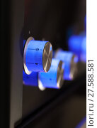 Купить «Blue rotary knobs on black panel», фото № 27588581, снято 16 июля 2018 г. (c) PantherMedia / Фотобанк Лори