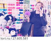 Купить «Woman with shopping bags using phone», фото № 27605581, снято 10 мая 2017 г. (c) Яков Филимонов / Фотобанк Лори