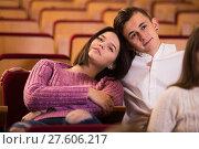 Купить «Loving young couple at date in cinema», фото № 27606217, снято 3 декабря 2016 г. (c) Яков Филимонов / Фотобанк Лори