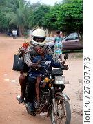 Купить «African road. Family on a motorbike.», фото № 27607713, снято 23 июня 2018 г. (c) age Fotostock / Фотобанк Лори