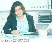 Купить «Businesswoman is having productive day at work», фото № 27607753, снято 21 мая 2017 г. (c) Яков Филимонов / Фотобанк Лори