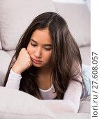 Купить «Young woman lying and melancholy», фото № 27608057, снято 30 мая 2017 г. (c) Яков Филимонов / Фотобанк Лори