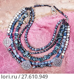 top view of gray blue necklace from gemstones. Стоковое фото, фотограф Valery Vvoennyy / PantherMedia / Фотобанк Лори