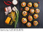 Купить «baked potatoes loaded with grated cheese», фото № 27613873, снято 3 февраля 2018 г. (c) Oksana Zh / Фотобанк Лори