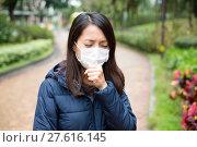 Купить «Woman wear facemask outdoor», фото № 27616145, снято 18 июня 2019 г. (c) PantherMedia / Фотобанк Лори