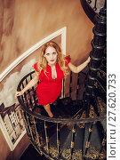 Купить «Beautiful blond woman red close-fitting dress», фото № 27620733, снято 8 апреля 2017 г. (c) katalinks / Фотобанк Лори