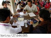 Купить «AMK microfinance and CARD disbursing funds for beneficiaries of a Unicef program.», фото № 27644085, снято 8 декабря 2019 г. (c) age Fotostock / Фотобанк Лори
