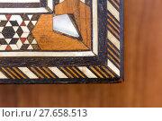 Купить «Close up of inlays on a box», фото № 27658513, снято 24 мая 2018 г. (c) PantherMedia / Фотобанк Лори