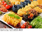 Купить «Composition with variety of pasta on kitchen table», фото № 27659469, снято 25 мая 2019 г. (c) PantherMedia / Фотобанк Лори
