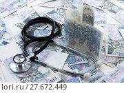 Купить «Czech paper money with stethoscope on white background», фото № 27672449, снято 25 июня 2019 г. (c) PantherMedia / Фотобанк Лори