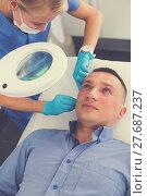 Купить «Woman doctor is examining patient before the procedure», фото № 27687237, снято 20 октября 2018 г. (c) Яков Филимонов / Фотобанк Лори