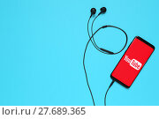 Купить «RUSSIA, Tyumen - February 10, 2018: Photo of mobile device with a YouTube search app running. Flat lay.», фото № 27689365, снято 10 февраля 2018 г. (c) Евгений Глазунов / Фотобанк Лори