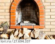 Купить «not kindled brick fireplace and firewoods», фото № 27694337, снято 26 марта 2019 г. (c) PantherMedia / Фотобанк Лори