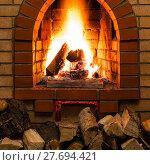 Купить «stack of wood and tongues of fire in fireplace», фото № 27694421, снято 26 марта 2019 г. (c) PantherMedia / Фотобанк Лори