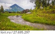 Купить «Foothills of the Mayon Volcano with flowing mountain rivers near Legazpi city in Philippines. Mayon Volcano is an active volcano and 2462 meters high.», видеоролик № 27695297, снято 26 января 2018 г. (c) Mikhail Davidovich / Фотобанк Лори