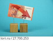 Купить «Euro currency decline illustrated over blue», фото № 27700253, снято 17 июня 2019 г. (c) PantherMedia / Фотобанк Лори