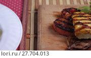 Купить «Grilled vegetables on a plate», видеоролик № 27704013, снято 19 ноября 2017 г. (c) Потийко Сергей / Фотобанк Лори