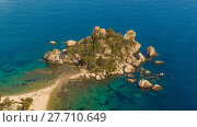 Купить «Aerial view of Isola Bella's island and beach on blue ocean water in Taormina - Sicily.», фото № 27710649, снято 21 октября 2018 г. (c) PantherMedia / Фотобанк Лори