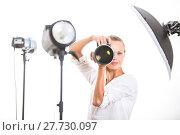 Купить «Pretty, female photographer with digital camera - DSLR and a huge telephoto lens (color toned image; shallow DOF)», фото № 27730097, снято 19 июля 2018 г. (c) PantherMedia / Фотобанк Лори