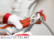 Купить «plumber screwing plumbing fittings in bathroom», фото № 27731461, снято 22 марта 2019 г. (c) PantherMedia / Фотобанк Лори