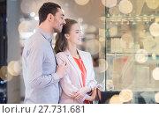 Купить «couple looking to shopping window at jewelry store», фото № 27731681, снято 10 ноября 2014 г. (c) Syda Productions / Фотобанк Лори