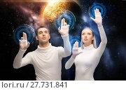Купить «couple using touch screen over space background», фото № 27731841, снято 17 ноября 2012 г. (c) Syda Productions / Фотобанк Лори