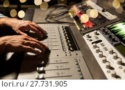 Купить «man using mixing console in music recording studio», фото № 27731905, снято 18 августа 2016 г. (c) Syda Productions / Фотобанк Лори