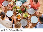 Купить «group of people at table praying before meal», фото № 27731953, снято 5 октября 2017 г. (c) Syda Productions / Фотобанк Лори