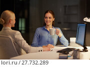 Купить «businesswomen drinking coffee at night office», фото № 27732289, снято 6 декабря 2017 г. (c) Syda Productions / Фотобанк Лори