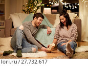 Купить «happy couple playing block-stacking game at home», фото № 27732617, снято 13 января 2018 г. (c) Syda Productions / Фотобанк Лори