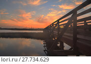 Купить «Wooden Boardwalk at sunset», фото № 27734629, снято 18 июня 2019 г. (c) PantherMedia / Фотобанк Лори
