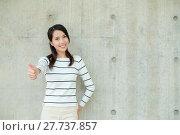 Купить «Asian woman showing thumb up», фото № 27737857, снято 23 апреля 2019 г. (c) PantherMedia / Фотобанк Лори