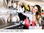 Купить «Female customer deciding on pretty bra», фото № 27738781, снято 20 марта 2017 г. (c) Яков Филимонов / Фотобанк Лори
