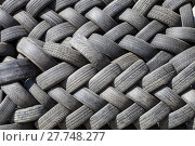 Купить «black rubber tires stacked zigzag, car wheel, garbage from vehicles, abstract art background, recycle object, reusable material», фото № 27748277, снято 24 января 2019 г. (c) PantherMedia / Фотобанк Лори