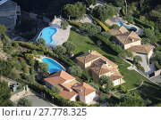 Купить «Aerial View of Luxurious Houses and Pools», фото № 27778325, снято 24 июня 2019 г. (c) PantherMedia / Фотобанк Лори