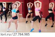 Купить «Slender women performing modern dance in fitness studio», фото № 27784985, снято 31 мая 2017 г. (c) Яков Филимонов / Фотобанк Лори