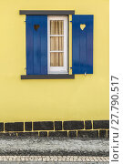 Купить «Blue window with hearts and yellow wall», фото № 27790517, снято 23 апреля 2019 г. (c) PantherMedia / Фотобанк Лори