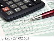 Купить «Калькулятор, таблица с цифрами и ручка», эксклюзивное фото № 27792633, снято 13 февраля 2018 г. (c) Юрий Морозов / Фотобанк Лори