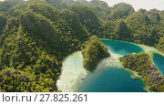 Купить «Coron, Palawan, Philippines, aerial view of beautiful Twin lagoon and limestone cliffs. Fisheye view.», видеоролик № 27825261, снято 5 февраля 2018 г. (c) Mikhail Davidovich / Фотобанк Лори