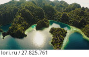 Купить «Coron, Palawan, Philippines, aerial view of beautiful Twin lagoon and limestone cliffs. Fisheye view.», видеоролик № 27825761, снято 5 февраля 2018 г. (c) Mikhail Davidovich / Фотобанк Лори