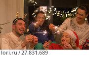 Купить «happy friends celebrating christmas at home party», видеоролик № 27831689, снято 22 декабря 2017 г. (c) Syda Productions / Фотобанк Лори