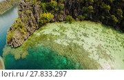 Купить «Coron, Palawan, Philippines, aerial view of beautiful Twin lagoon and limestone cliffs. Fisheye view.», видеоролик № 27833297, снято 5 февраля 2018 г. (c) Mikhail Davidovich / Фотобанк Лори
