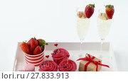 Купить «red sweets and champagne in st valentines day», видеоролик № 27833913, снято 10 февраля 2018 г. (c) Syda Productions / Фотобанк Лори