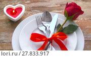Купить «close up of red rose flower on set of dishes», видеоролик № 27833917, снято 10 февраля 2018 г. (c) Syda Productions / Фотобанк Лори