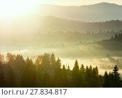 Купить «First sunrise rays of sun in Carpathian mountains.», фото № 27834817, снято 18 октября 2017 г. (c) Юрий Брыкайло / Фотобанк Лори