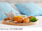 Купить «Breakfast on tray in bed in hotel room», фото № 27838669, снято 27 марта 2019 г. (c) PantherMedia / Фотобанк Лори