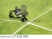 Купить «aerial view to house with crossing bicycle ways», фото № 27839789, снято 23 февраля 2018 г. (c) PantherMedia / Фотобанк Лори