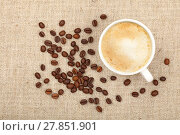 Купить «Latte cappuccino cup and coffee beans on canvas», фото № 27851901, снято 15 августа 2018 г. (c) PantherMedia / Фотобанк Лори