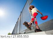 Купить «African girl in roller skates posing at skate park», фото № 27855553, снято 14 октября 2017 г. (c) Сергей Новиков / Фотобанк Лори