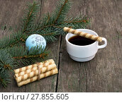 Купить «coffee, baking on a cup and nearby and a coniferous branch with scenery, a still life», фото № 27855605, снято 20 августа 2019 г. (c) PantherMedia / Фотобанк Лори